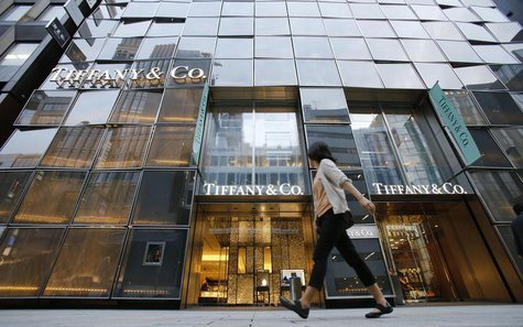 A woman walks past Tiffany Building at Tokyo's Ginza shopping district October 1, 2013. REUTERS/Toru Hanai