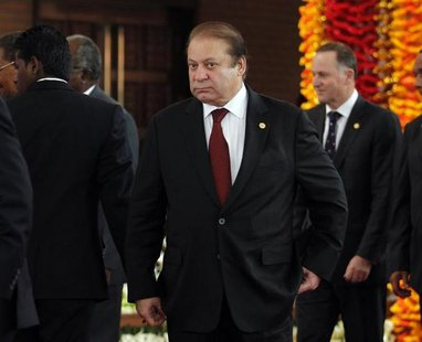 Pakistan's Prime Minister Nawaz Sharif arrives for the official photograph of the Commonwealth heads of states during the opening ceremony o