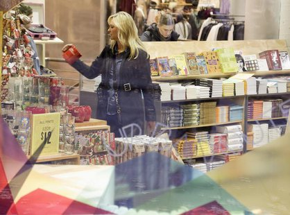 A woman shops in downtown Seattle, Washington November 16, 2013. REUTERS/Jason Redmond
