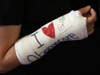 Cathey Park of Cambridge, Massachusetts shows her cast signed by U.S. President Barack Obama after he spoke about health insurance at Faneui