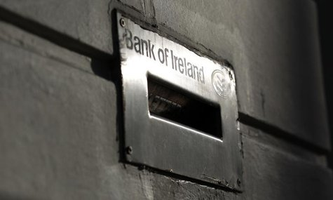 Sunlight is reflected off a deposit box on the exterior of a Bank Of Ireland branch in Belfast November 12, 2010. REUTERS/Cathal McNaughton