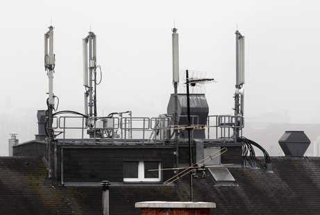 Mobile network antennas are pictured atop the roof of a house in Vienna October 22, 2013. REUTERS/Heinz-Peter Bader