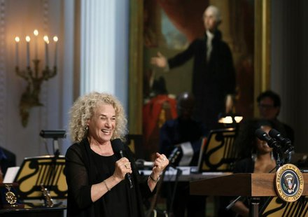 Singer Carole King speaks after U.S. President Barack Obama presented her the 2013 Library of Congress Gershwin Prize for Popular Song at an