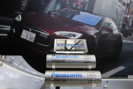 Panasonic Corp's lithium-ion batteries, which are part of Tesla Motor Inc's Model S and Model X battery packs, are displayed in front of a p
