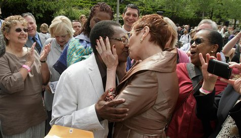 Vernita Gray (L) and Pat Ewert kiss after their Civil Union ceremony in Chicago, in this file photo from June 2, 2011. REUTERS/John Gress