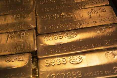 24 karat gold bars are seen at the United States West Point Mint facility in West Point, New York June 5, 2013. REUTERS/Shannon Stapleton