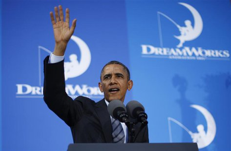 U.S. President Barack Obama waves after speaking to workers on the economy at DreamWorks Animation in Glendale, California, November 26, 201
