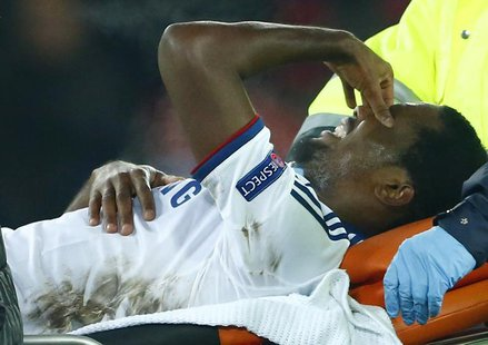 Chelsea's Samuel Eto'o grimaces as he is carried off injured during his team's Champions League Group E soccer match against FC Basel at St.