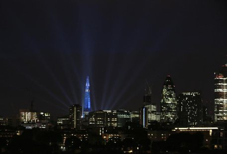 A laser and searchlight show marks the completion of the exterior of the Shard building in central London July 5, 2012. REUTERS/Olivia Harri