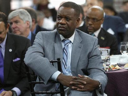 Detroit Emergency Manager Kevyn Orr listens to a panel discussion following a news conference announcing a $20 million partnership to bring
