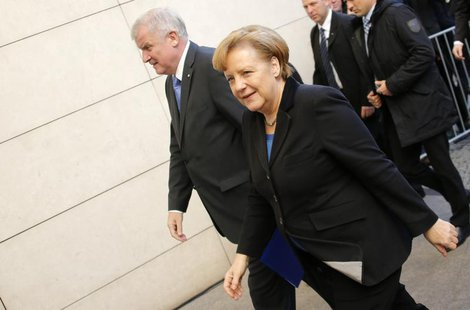 The head of the Christian Democratic Union (CDU) German Chancellor Angela Merkel (R) and the head of the Christian Social Union (CSU) Horst