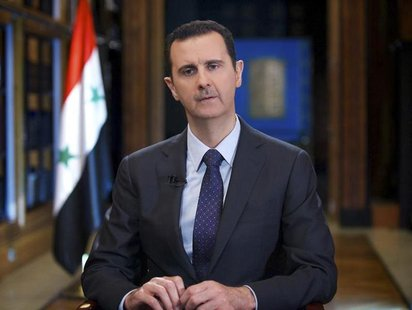 Syria's President Bashar al-Assad speaks during an interview with Venezuelan state television TeleSUR in Damascus, in this handout photograp