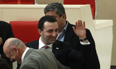 Georgia's Prime Minister Irakly Garibashvili (C) waves as he is congratulated by members of parliament during a session in parliament in Kut