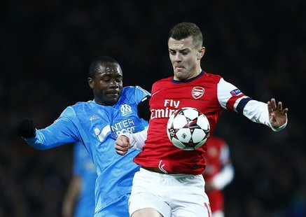 Arsenal's Jack Wilshere (R) challenges Olympique Marseille's Giannelli Imbula during their Champions League soccer match at the Emirates sta
