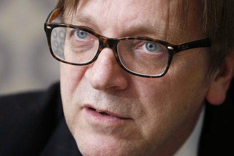 Guy Verhofstadt, former Belgian prime minister and leader of the liberals in the European Parliament, answers reporters' questions during th