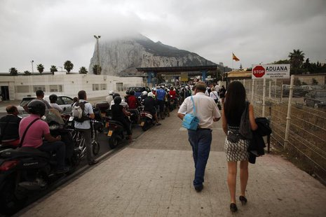 Vehicles wait to enter the British territory of Gibraltar at its border with Spain September 25, 2013. REUTERS/Jon Nazca