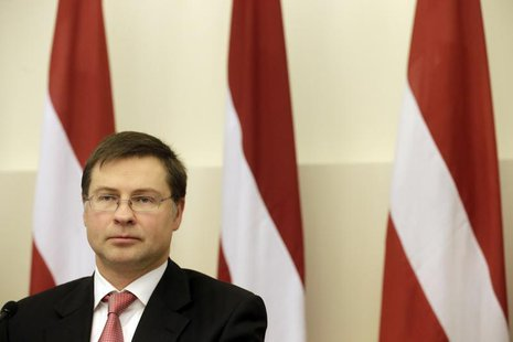 Latvia's Prime Minister Valdis Dombrovskis listens during a news conference in Riga November 8, 2013. REUTERS/Ints Kalnins