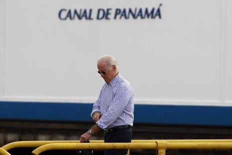 U.S. Vice President Joe Biden walks on top of the lock gates during a visit to the Miraflores Locks of the Panama Canal in Panama City Novem