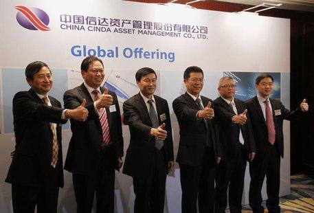 (L-R) China Cinda Asset Management Co Ltd Vice President Gu Jianguo, Vice President Xu Zhichao, Chairman Hou Jianhang, President Zang Jianfa