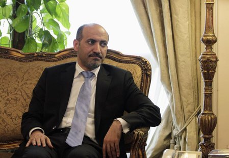 President of the Syrian National Coalition Ahmad Al-Jarba looks on during his meeting with Egypt's Foreign Minister Nabil Fahmy (not picture