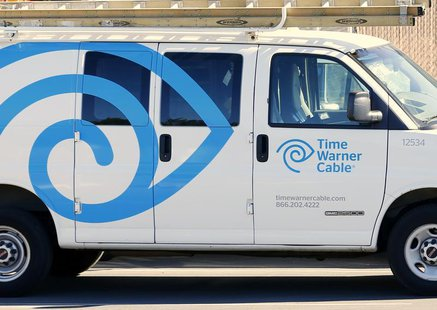 A Time Warner Cable truck sits parked at its office in Carlsbad, California November 5, 2012. REUTERS/Mike Blake
