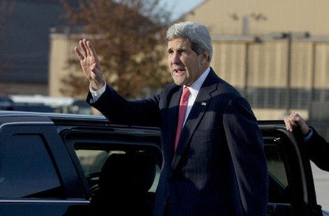 U.S. Secretary of State John Kerry waves before getting into his motorcade vehicle as he arrives at Andrews Air Force Base, Maryland, Novemb