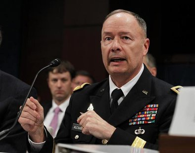 U.S. General Keith Alexander, director of the National Security Agency, testifies at a House Intelligence Committee hearing on Capitol Hill