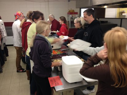 Members of the Elkhart Lake-Glenbeulah FCCLA serve a Thanksgiving meal they cooked to students and senior citizens.