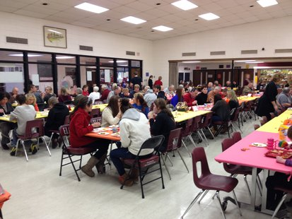 Students of Elkhart Lake-Glenbeulah High School and their grandparents enjoy a Thanksgiving meal together.