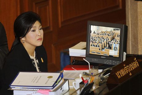 Thailand's Prime Minister Yingluck Shinawatra listens to a debate by the opposition in parliament in Bangkok November 26, 2013. REUTERS/Chai