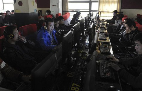 Customers use computers at an internet cafe in Hefei, Anhui province March 16, 2012. REUTERS/Stringer