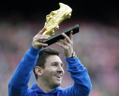 Barcelona's soccer player Lionel Messi poses with the Golden Boot trophy before their Spanish first division league match against Granada at