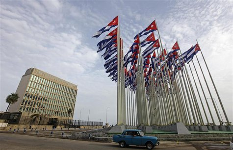 A car drives past the building of the the U.S. diplomatic mission in Cuba, The U.S. Interests Section, (USINT), in Havana, in this September