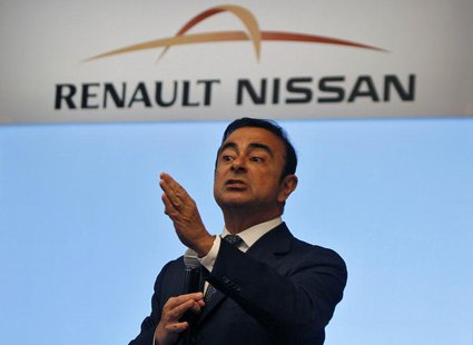 Carlos Ghosn, chairman and CEO of the Renault-Nissan Alliance, gestures as he speaks at a news conference in the southern Indian city of Che