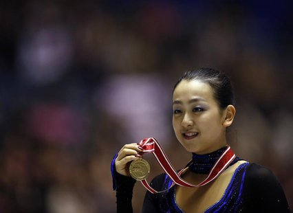 Mao Asada of Japan poses with her gold medal during the award ceremony for the women's free skating programme at the ISU Grand Prix of Figur