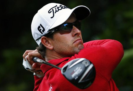 Australia's Adam Scott hits a drive on the second hole during the second round of the Australian Open golf tournament at Royal Sydney Golf C
