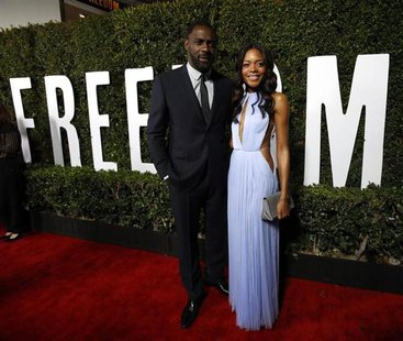 "Cast members Idris Elba and Naomie Harris pose at the premiere of ""Mandela: Long Walk to Freedom"" in Los Angeles, California November 11, 20"