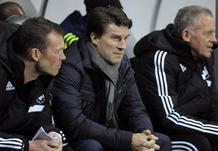 Swansea's manager Michael Laudrup (C) during their Europa League soccer match against Valencia at the Liberty Stadium in Swansea, Wales, Nov