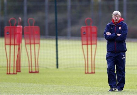 Arsenal's manager Arsene Wenger attends a team training session at their training ground in London Colney, north of London, November 25, 201
