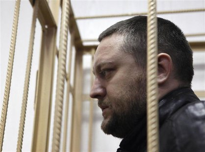 Yury Zarutsky looks out from the defendant's holding cell during a court hearing in Moscow in this March 7, 2013 file photo. REUTERS/Maxim S