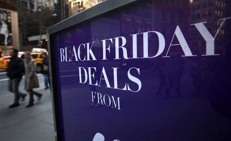 A sign along 5th Ave is pictured during Black Friday Sales in New York November 29, 2013. REUTERS/Carlo Allegri