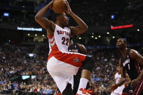 Nov 29, 2013; Toronto, Ontario, CAN; Toronto Raptors forward Rudy Gay (22) goes up to shoot as Miami Heat center-forward Chris Bosh (1) look
