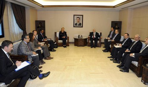 Syrian Foreign Minister Walid al-Muallem (center R) meets Sigrid Kaag (center L), Special Coordinator of the Organisation for the Prohibitio