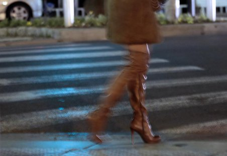 A prostitute from Eastern Europe waits for customers along the Promenade des Anglais in Nice, November 29, 2013. REUTERS/Eric Gaillard
