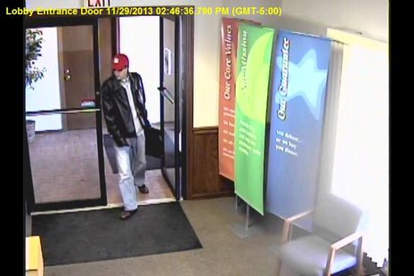 The suspect in the robbery of the Monarch Community Bank branch in Marshall on November 29, 2013, as seen in this security video still.