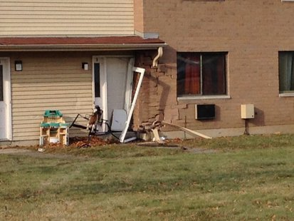Damage to Green Bay apartment building where teenager slammed his pickup truck into on Nov. 30, 2013. (Photo from: FOX 11).