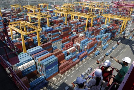 People look at Hanjin Shipping's container terminal at the Busan New Port in Busan, about 420 km (261 miles) southeast of Seoul August 8, 20