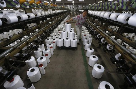 An employee works inside a textile factory in Linhai, Zhejiang province, May 30, 2013. REUTERS/William Hong