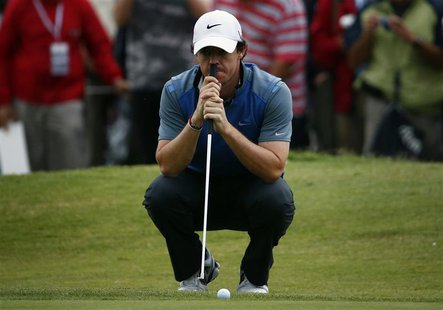 Northern Ireland's Rory McIlroy leans on his putter on the eighth hole during the second round of the Australian Open golf tournament at Roy