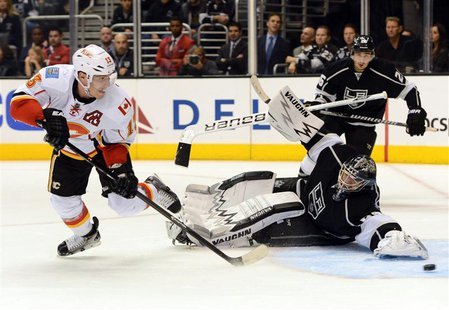Nov 30, 2013; Los Angeles, CA, USA; Calgary Flames left wing Mike Cammalleri (13) scores the game winning goal past Los Angeles Kings goalie